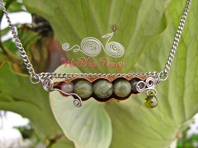 wire wrapped Peas in a Pod pendant using copper sheet and gemstones