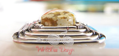 side view of the swirly wire wrap square pendant with square jasper