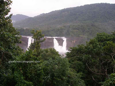 athirapally-waterfalls-of-kerala,distant-view-of-athirapilly-river-falls,indian-niagrs,7-wonders-of-kerala,three-streams-of-athirapally-waterfalls