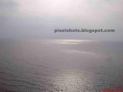 calm sea of kovalam, photo from top of lighthouse, kerala ocean photos, calm arabian sea photos, sea photos from top of lighthouses