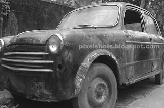 front grill of old fiat car, old cars in Kerala, cars of Kerala in olden times, 1950s model cars in India kerala,kerala fiat cars, abandoned cars in garages of kerala,rusting old car,Cochin car mechanic garages