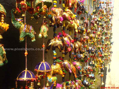 elephant toys in the front of a street shop from the oldest jew street in india at cochin kerala,decoratives,decoration toys,house decorations,cheap toys,street side shop decoratives,cochin,kerala