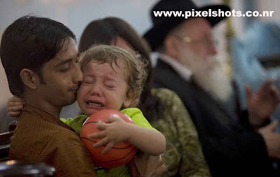 mumbai terrorist attack victims small baby child crying for losing his parents in the gun fire