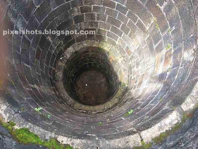 tookupalam kinar,inside of four wells of punalur hanging bridge,wells of suspension bridge,hanging bridges chain anchoring wells,kerala hanging bridge wells,wells of punalur palam