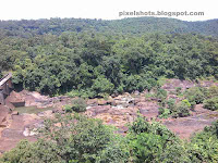 thenmala lookout tower view,ottakkal lookout,thenmala lookout point view of kallada river course,dry river course filled with rocks,thenmala photos,kallada irrigation project main point,view from watchtower thenmala ottakkal