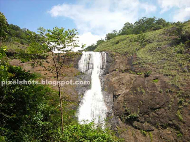 monsoon season falls,palaruvy waterfalls photo during monsoons,milky waterfalls of kerala state,waterfall tourism,2 step waterfalls,2 pool waterfall,ayurvedic bathing point of nature,waterfalls bathing points in kerala