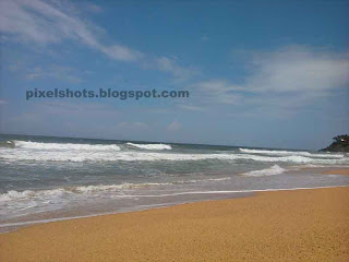 fine beaches of kerala photographed during beach tour trips, beach sand getting washed by sea wave, varkala beach photos