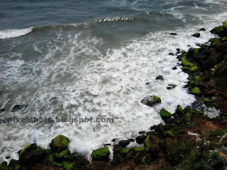 sea waves hitting beach rocks photographed from varkala beaches of kerala-india,famous south indian beaches,trivandrum beaches