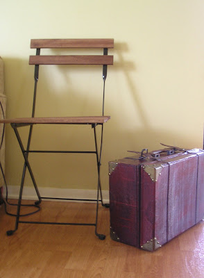 Use a vintage chair and a suitcase to make a quick and easy side table