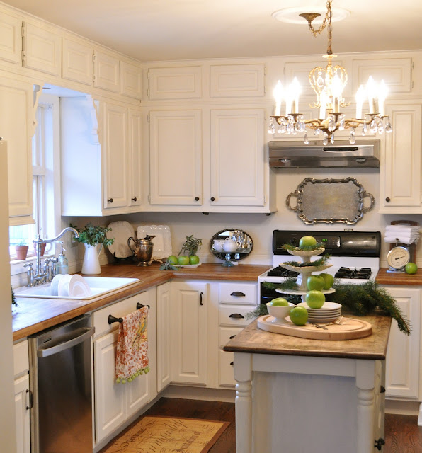 White kitchen cabinets and vintage chandelier