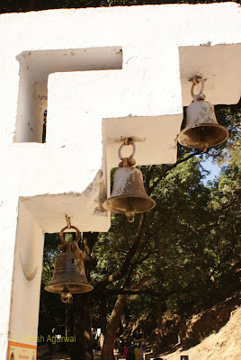 Bells hanging outside the entrance to the Bada Mahadev complex in Pachmarhi