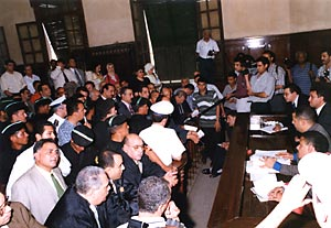 [After+mayhem,+security+forces+are+peppered+around+the+courtroom+to+keep+the+peace+mahran+case+1+July.jpg]