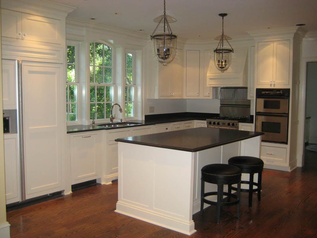 Black and White Kitchen Cabiwith Granite