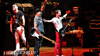 Edge y Muse en Glastonbury
