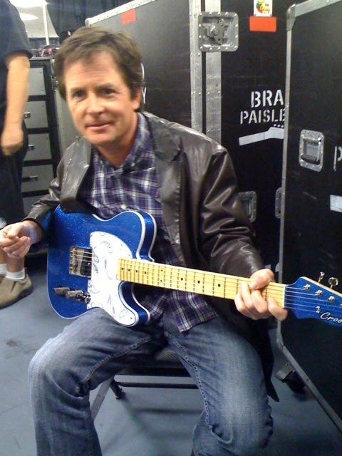Michael J Fox Michael J Fox Playing Guitar And Ice Skating