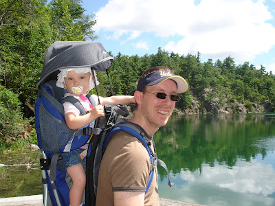 Image of a man with a baby on his back