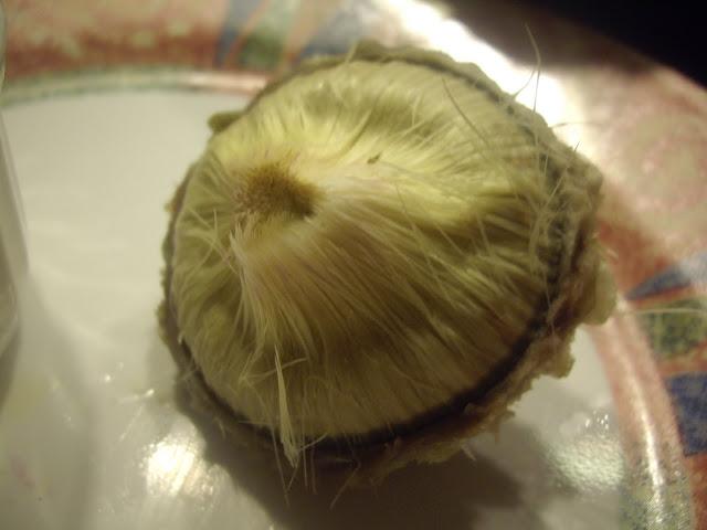 A cooked artichoke heart.