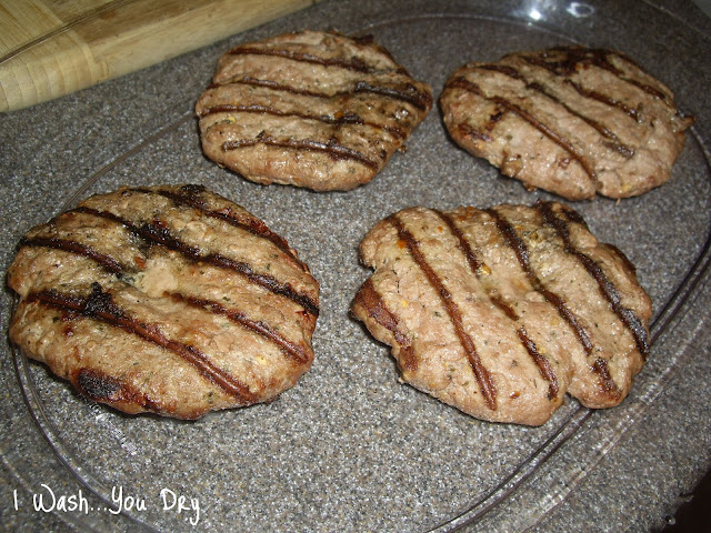 Grilled turkey patties in a glass dish on a counter.