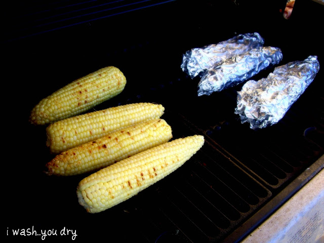 Cobs of corn on a grill.