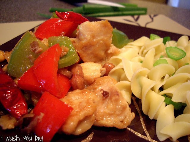 Chicken, veggies and noodles on a plate.