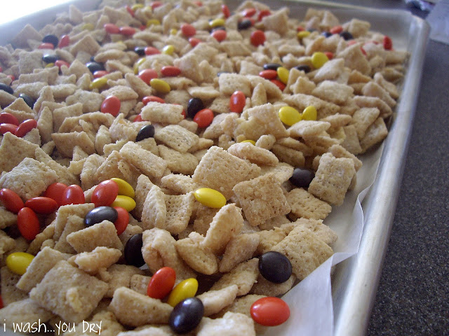 Close up of cereal and Reeses Pieces on a baking pan