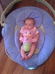 Baby Darah in Boppy Bouncer with Gloworm