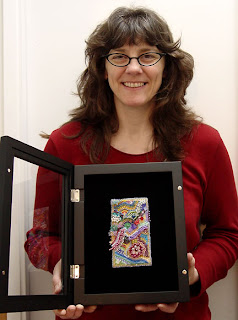 Kathy Hinkle with her bead embroidery, photo by Robin Atkins