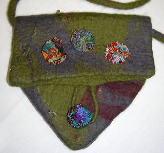felt purse by Una, beaded button by Una, beaded buttons by students