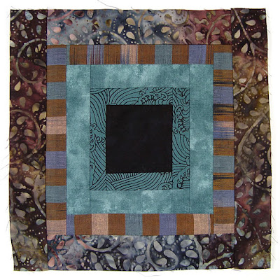 God's Eye Quilt, block 1, by Robin Atkins