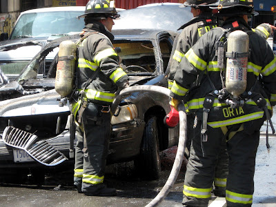 Firemen Fight Car Fire