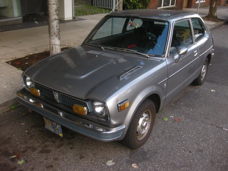 OLD PARKED CARS.: 1976 Honda Civic Hatchback.