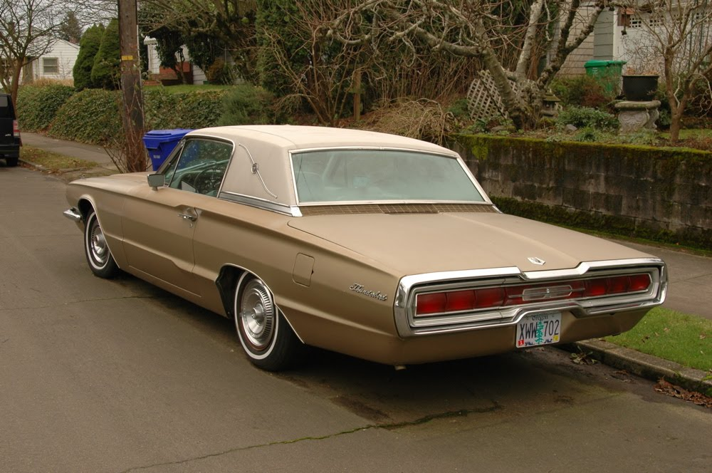 OLD PARKED CARS.: 1966 Ford Thunderbird Coupe.