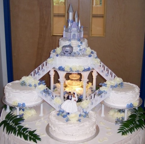 Multi Tiered Cinderella Castle Wedding Cake In Soft Metallic Blue Tiers Are Separated With Staircases