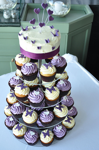 wedding cake and cupcakes purple emanuela s traditionally wedding invitations were 21733