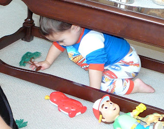 Child playing under a table