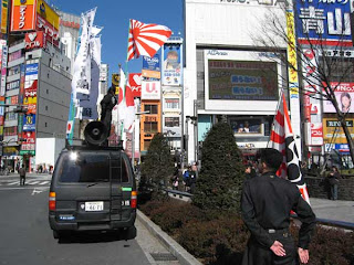 Right wingers outside Shinjuku Station on National Foundation Day.
