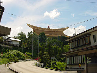 Sukyo Mahikari World Shrine rises above the rooftops of the local neighborhood, Takayama, Gifu