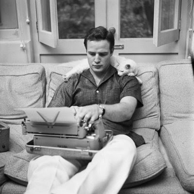 Marlon Brando and a Royal typewriter, and feline friend - from cracktwo.com