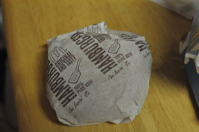 McDonald's Hamburger in its wrapper