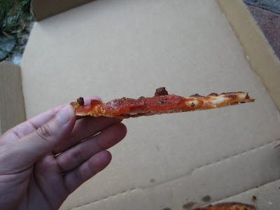 Domino's Thin Crust Pizza slice side view