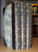 "A three-volume set of ""The Whale"" in marbled boards."