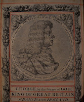 A page printed in black with red accents, showing a portrait in profile of King George.