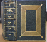 "The spine and cover of a leather-bound volume titled ""The Seven Pillars."""