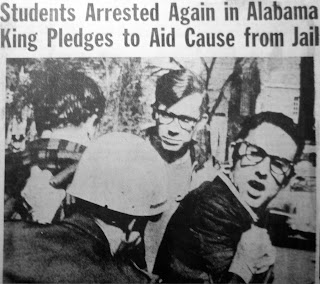 "A newspaper article with the title ""Students Arrested Again in Alabama King Pledges to Aid Cause from Jail"