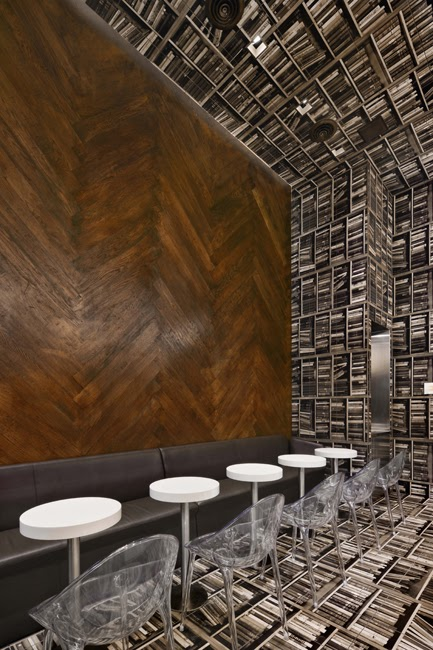 chair upside down on wall adrian pearsall dining chairs peppermags interior cafe i love the herringbone wood floor behind banquette and pendant lights that come straight out from
