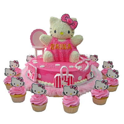 fbd399262 The Hello Kitty and the base are made of chocolate cake and iced in  buttercream. Everything is edible.