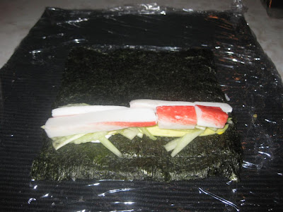 how to roll california rolls, roll in rice, seaweed, nori, crab, cucumber
