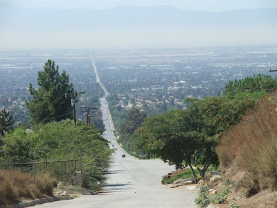 road into california, smog, straight road, hill