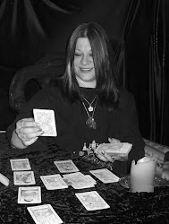 Ms Faith reading the tarot