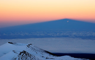 eclipsed moon rising at Mauna Kea